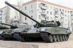 The average T-72 tank costs in the city. VOLGOGRAD, RUSSIA - April 07, 2018: The average T-72 tank costs in the city against the background of the multi-storey Royalty Free Stock Image