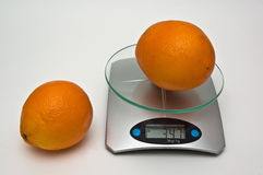 Average weight of  orange. Royalty Free Stock Photography