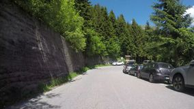 Time lapse driver point of view on scenic routes from Saint Marco mountain pass to the bottom of the valley. Averara, Bergamo, Italy. Camera on car roof. Time stock footage