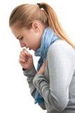 Avere il raffreddore della giovane donna Immagini Stock