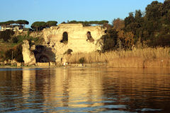 Averno lake. Pozzuoli (near Naples) The averno lake with the Apollo temple on the background at the sunset royalty free stock photography