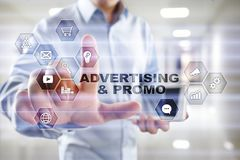 Avertising, marketing strategy. Icons and graphs on virtual screen. Business, internet and technology concept.  Royalty Free Stock Image