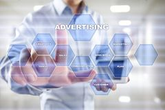 Avertising, marketing strategy. Icons and graphs on virtual screen. Business, internet and technology concept. Avertising, marketing strategy. Icons and graphs Royalty Free Stock Photo