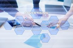 Avertising, marketing strategy. Icons and graphs on virtual screen. Business, internet and technology concept. Avertising, marketing strategy. Icons and graphs Stock Photo
