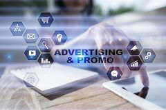 Avertising, marketing strategy. Icons and graphs on virtual screen. Business, internet and technology concept. Avertising, marketing strategy. Icons and graphs Stock Photos