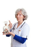 Avertissement de médecin avec des pillules Images libres de droits