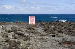 Avertissement de trou de coup de plage image libre de droits