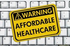 Avertissement des soins de santé abordables Images libres de droits