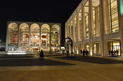 Avery Fisher Hall Entrance. Avery Fisher Hall is in Lincoln Center for the Performing Arts is in New York City. Metropolitan Opera House is shown to the left of Stock Photos