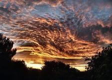 Avfyra i skyen Arkivbild