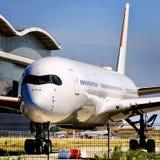 Avião branco da etiqueta fotografia de stock