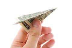 Avião de papel do dólar imagem de stock