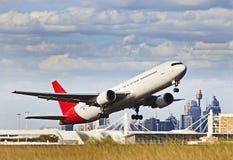 Avião fora contra CBD Imagem de Stock Royalty Free