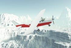 Avião pequeno em montanhas da neve fotografia de stock royalty free