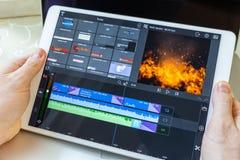 Avión blanco a disposición Programa que corrige video en pantalla imagen de archivo libre de regalías