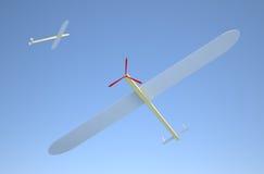 Avión de madera modelo en el cielo Foto de archivo libre de regalías