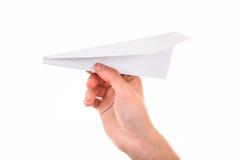 Avión de papel en una mano Fotos de archivo libres de regalías