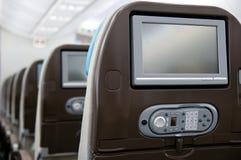 Avión de pasajeros a bordo del sistema del entretenimiento Imagen de archivo