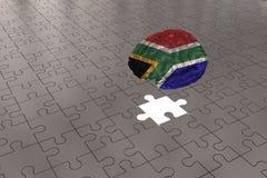 Avión de plata del rompecabezas para la bandera de Suráfrica al cerebro foto de archivo