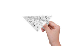 Avión del papel cuadriculado del asimiento de la mano Imágenes de archivo libres de regalías