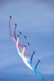 Aviões de jato aerobatic da força aérea vermelha do RAF da seta Foto de Stock