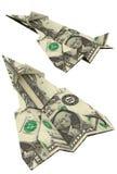 Aviões de papel do origâmi feitos fora do dinheiro do dólar Fotos de Stock Royalty Free