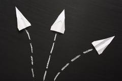 Aviões de papel em um quadro-negro Fotografia de Stock Royalty Free