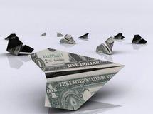 Aviões de papel feitos das notas de dólar Fotos de Stock