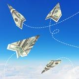 Aviões de papel feitos de cem notas de dólar Imagem de Stock Royalty Free