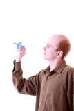 Aviões do papel da terra arrendada do homem de negócios Fotos de Stock Royalty Free