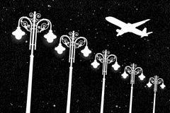 Aviões do voo e postes de luz do vintage na noite Imagem de Stock