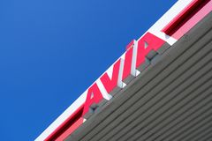 Avia sign at gas station against blue sky. With around 3,000 filling stations Avia is the most widely used group-independent mineral oil brand in Europe Royalty Free Stock Photos