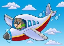 Aviador dos desenhos animados no céu azul Fotos de Stock Royalty Free