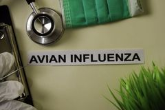 Avian Influenza with inspiration and healthcare/medical concept on desk background. N royalty free stock photos