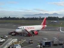 Avianca A320 at Bogota Airport. An Airbus A320 of Avianca in a gate at SKBO ElDorado International in the International Terminal royalty free stock photo
