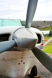Aviation. A small single engine propeller aircraft parked in front of an airstrip waiting for its pilot Stock Photography