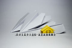 Aviation academy. Conceptual image with planes, letters and building block royalty free stock photos