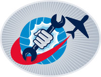 Aviation aircraft mechanic hand spanner. Illustration of a aviation mechanic hand holding a spanner with airplane flying over globe set inside oval Stock Photography