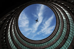 Aviation, Airplane, Architecture. Aviation or plane from a see through architecture hole Royalty Free Stock Photography