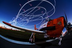 Aviation Art in the Night Sky!. Bob Carlton flawlessly performs his night aerobatic routine in the darkening skies over Sun-n_Fun, Lakeland, Florida Stock Photos