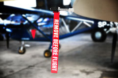 Aviation detail - remove before flight ribbon. Aviation & airplane detail - remove before flight ribbon in a Pitot tube Royalty Free Stock Photo