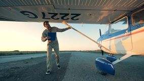 Aviation engineer is inspecting an aircraft before the flight. 4K stock footage