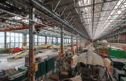 Aviation factory of military aircraft. Assembly of the Russian multirole fighter. Room with many pla Stock Image