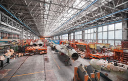 Aviation factory of military aircraft. Assembly of the Russian multirole fighter. Room with many planes Royalty Free Stock Photography