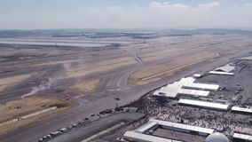 Aviation festival airport parachutes landing. Filmed by steady drone from distance stock video footage
