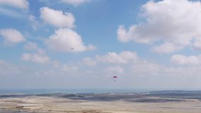 Aviation festival stunt parachutes landing aerial view. Filmed by steady drone from distance stock video footage