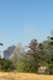 Aviation fire fighting over brush fire Royalty Free Stock Images