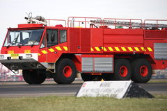 Aviation fire truck on airport runway. Emergency airport fire rescue vehicle Royalty Free Stock Photography