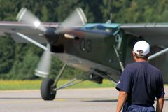 Aviation mechanic. Watches a prop airplane (Pilatus PC6 Royalty Free Stock Photography