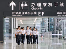 Aviation personell at Pudong Airport, Shanghai, China. SHANGHAI-AUG. 30, 2010. Aviation personnel at Pudong Airport, one of two international airports of Royalty Free Stock Photos